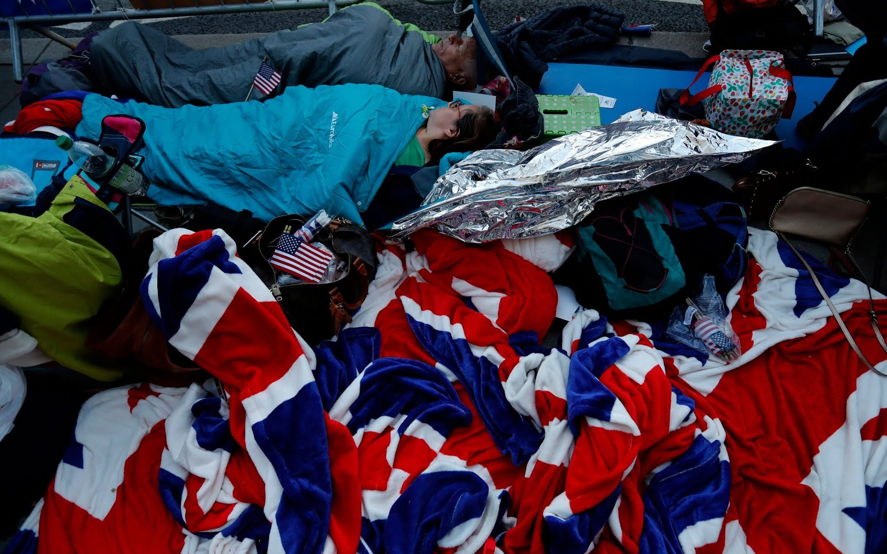 Royal fans in their sleeping bags to hold a spot at the front of barriers for the carriage procession outside Windsor Castle,