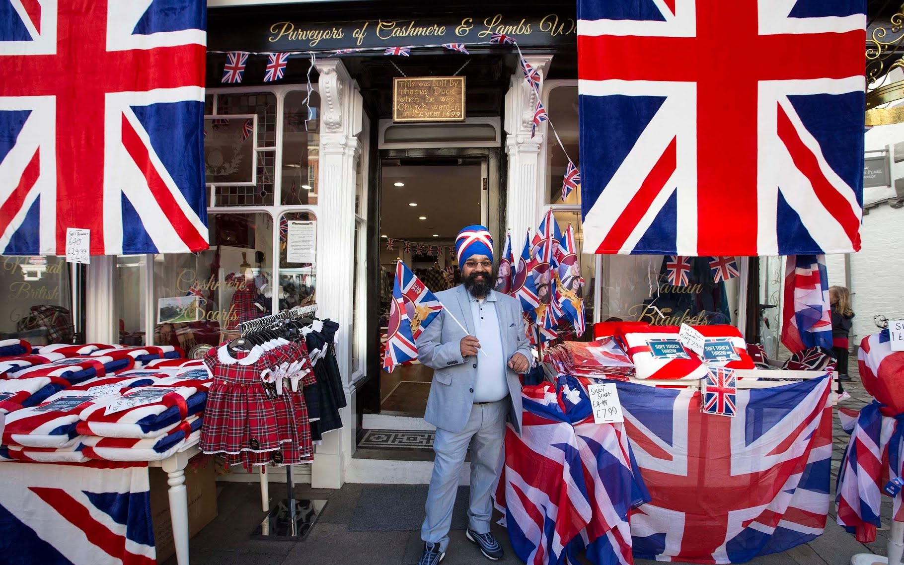 Shopkeeper Roshan Sang outside his store on Windsor High Street