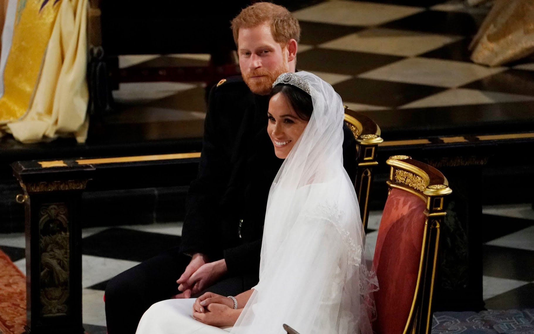 Prince Harry and Meghan Markle beam with joy in St George's Chapel