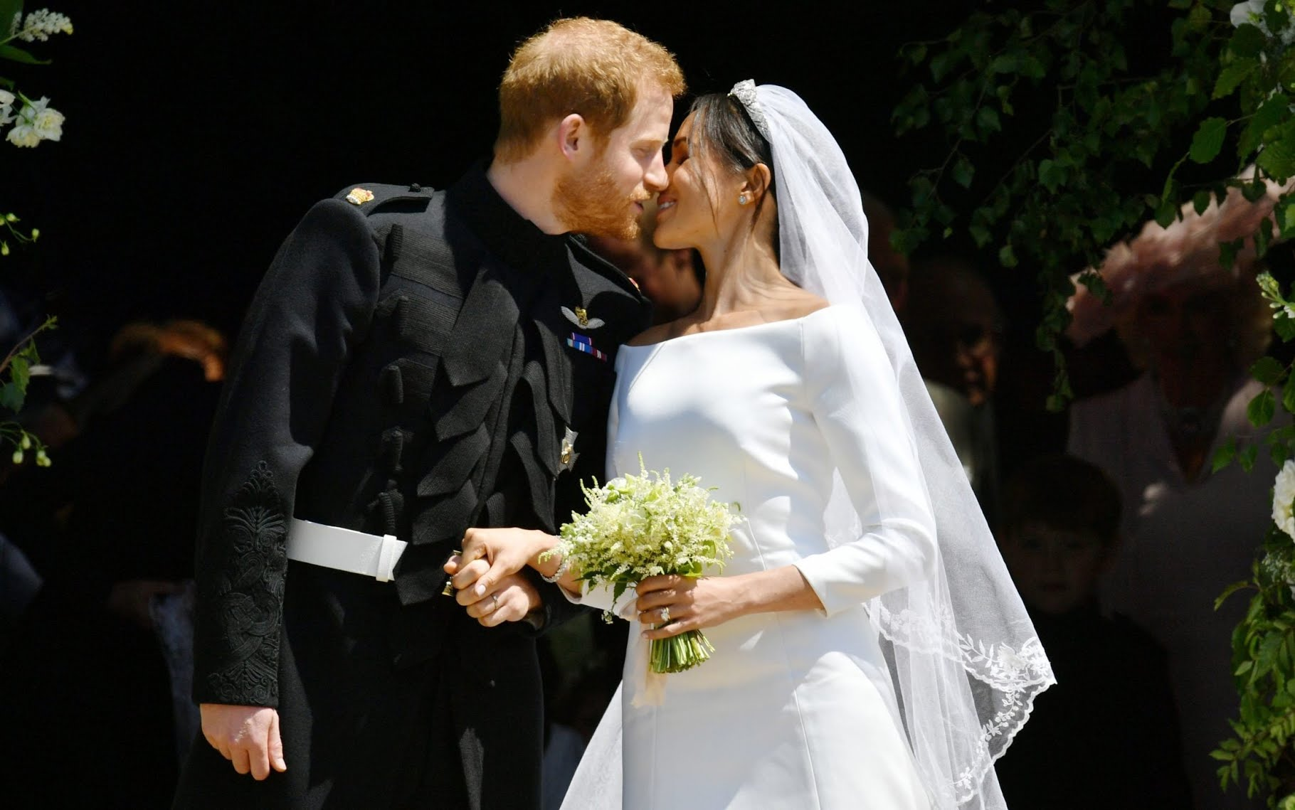 Prince Harry and Meghan Markle kiss on the steps of St George's Chapel