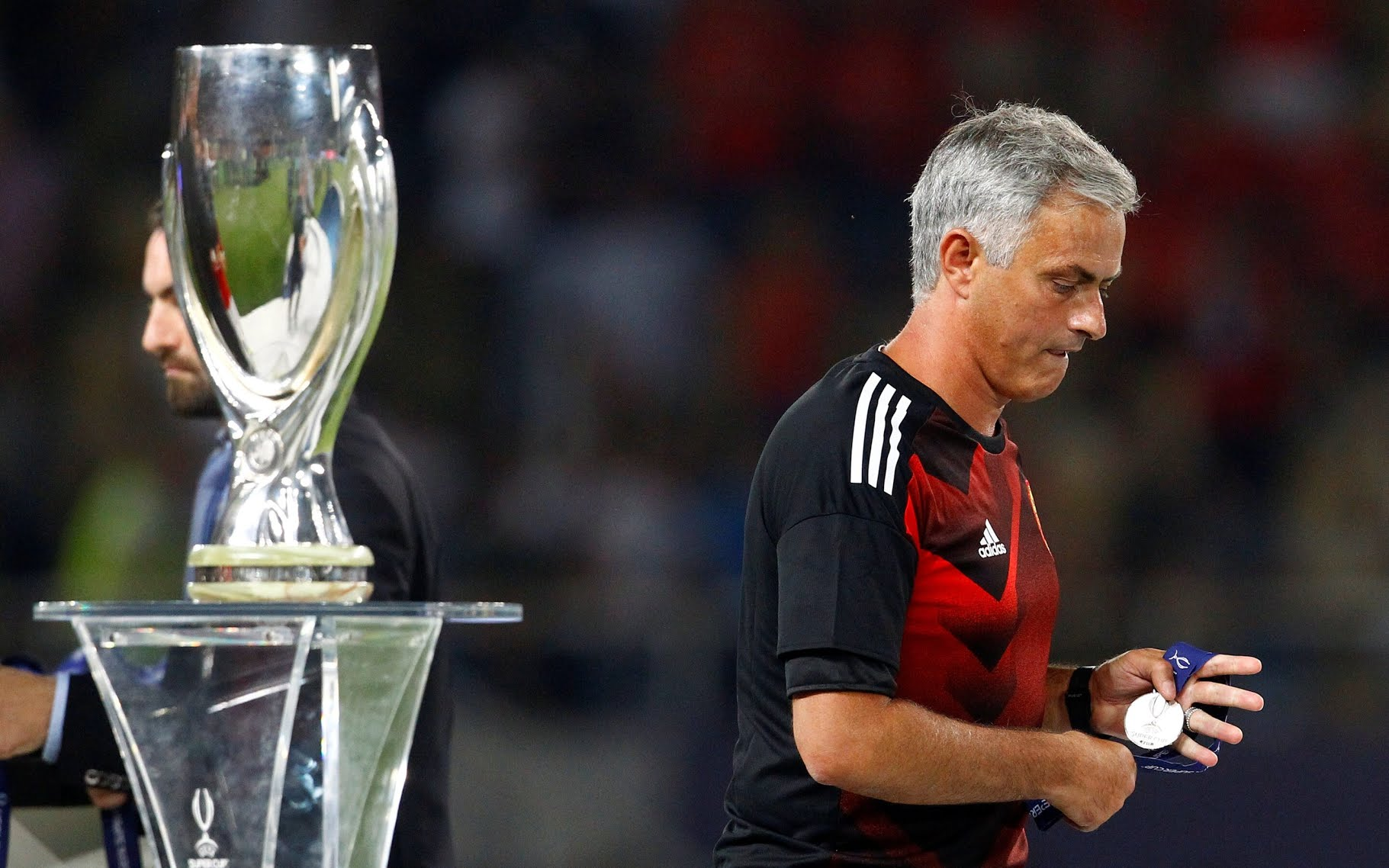 Jose Mourinho walks away with his runners up medal