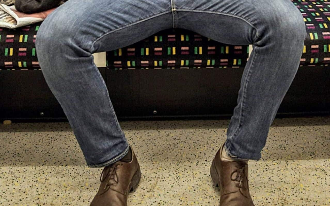 "Madrid's EMT transport corporation has unveiled a new set of stickers to be placed on all city buses including one of a male figure with his knees spread wide apart, accompanied by the slogan ""Respect others' space""."