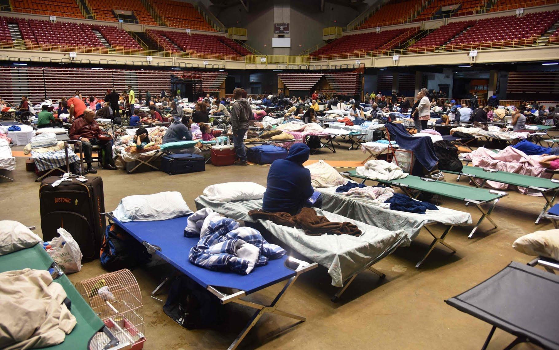 Puerto Ricans take refuge at a shelter in San Juan